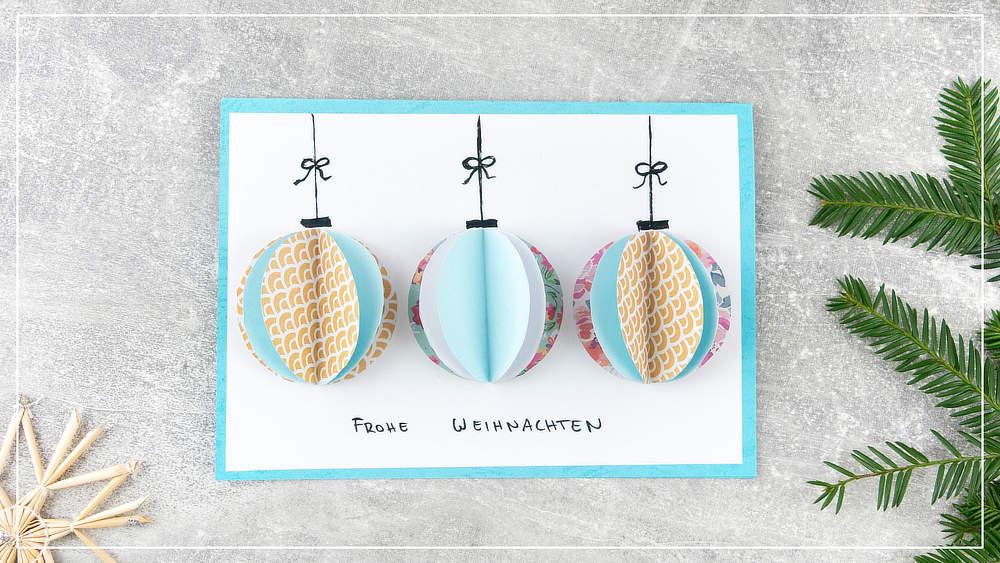 Weihnachtskarte mit 3 Christbaumkugeln
