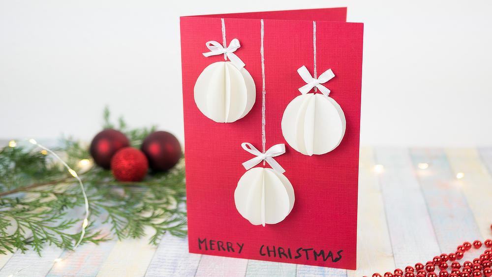 Weihnachtskarte mit 3 Christbaumkugeln, rot